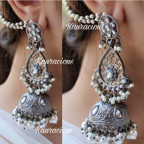 Oval shaped layered kundan studded black metal jhumki earrings | kauracious.com