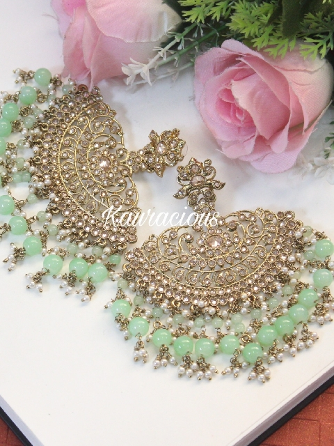 Gold plated & pearl crescent shaped traditional reverse AD kundan earrings | kauracious.com