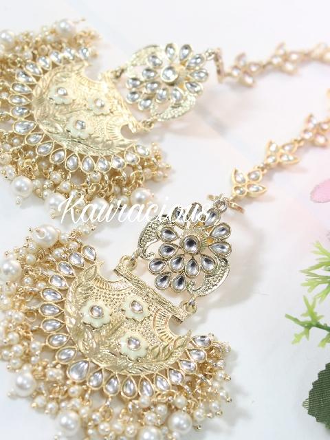 Gold toned & faux pearls kundan earrings with ear chain. | kauracious.com